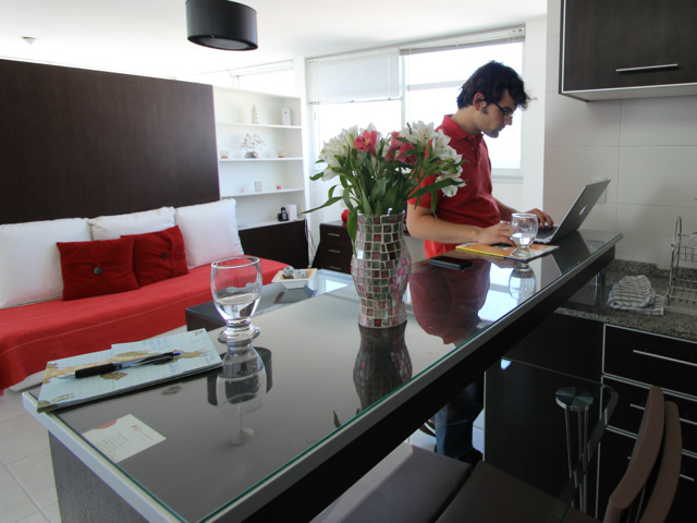 working from the breakfast bar at our first apartment